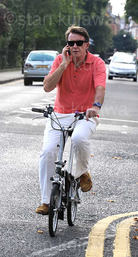 Lord Peter Mandelson on his Brompton folding bicycle, aka Mandy, one of the founders of New Labour
