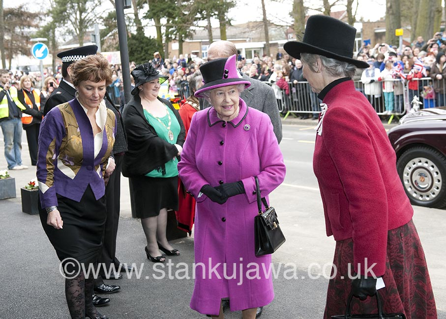 Her Majesty the Queen visits Slough, Berks, England, officially opening the Britwell Community Centre, accompanied by HRH Prince Philip.  She was wearing a pink Cerise Angela Kelly outfit. 05.04.2013. ©Stan Kujawa. 2013. All Rights Reserved