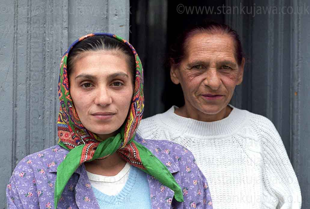 Roma daughter and mother in Sibiu Romania, 2004. ©Stan Kujawa. All Rights Reserved.