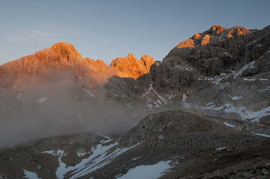 Mount Triglav, on right, the tallest peak in Slovenia, in the Julian Alps. During sunset.  Taken on Nikon D90, 17-35mm f2.8 AFS at 17mm (22mm equivalent), ISO 100, f11 at 1/40s handheld.  ©Stan Kujawa 2012. All rights reserved. Image may not be used without express written permission of photographer.