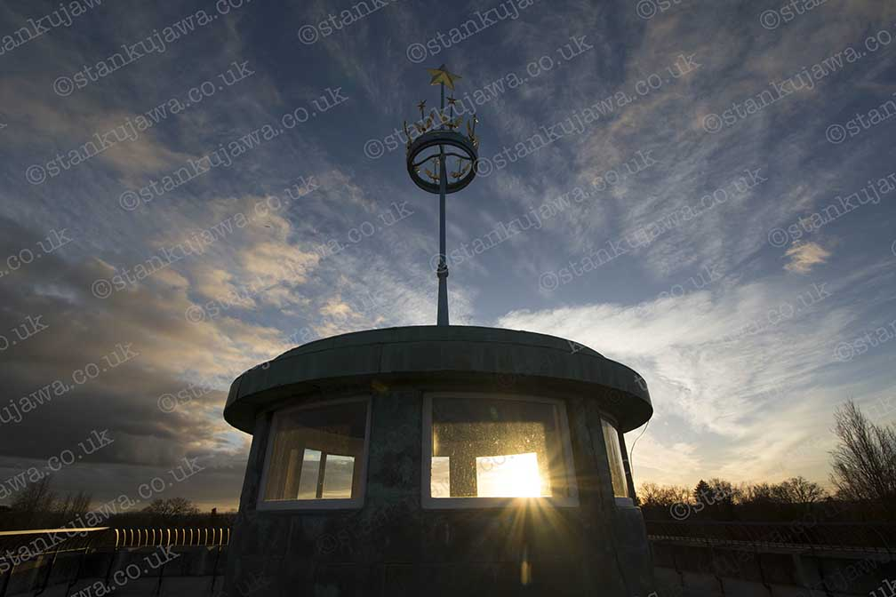 Sun sets over the roof of the Runnymede Airforces Memorial, near Egham, Surrey. It is maintained by the Commonwealth War Graves Commission and houses the names of fallen Commonwealth airmen with no known grave.  24/12/2014.   Photo ©Stan Kujawa stan.pix@virgin.net www.stankujawa.co.uk